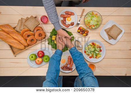 Top View Of Business People Shaking Hands Agreement While Having Dinner Together