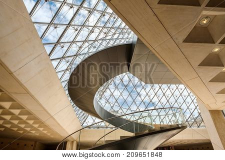 PARIS,FRANCE - JULY 31,2017 : Main hall under the glass pyramid at the Louvre Museum