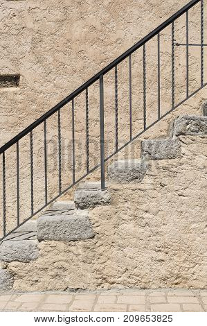 Iron black handrail on a house in the provence France