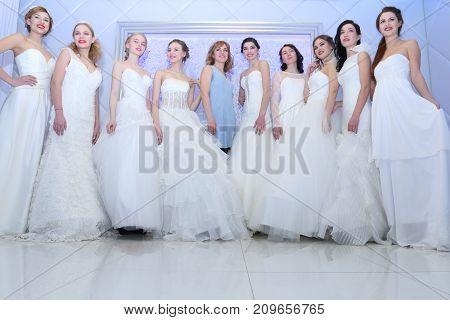 PERM RUSSIA - FEB 12 2017: Pretty models brides and stylist pose at Wedding Fair Perm 2017