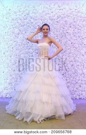 PERM RUSSIA - FEB 12 2017: Pretty model bride poses at Wedding Fair Perm 2017