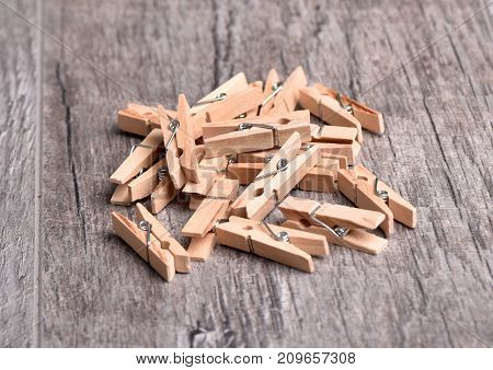 Clothespins on the table. Household goods. Brushes for drying clothes.Wooden clothespins.
