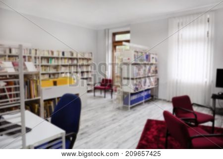 Cozy reading room in library, blurred background