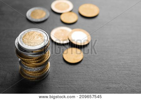 Stack of coins on dark background