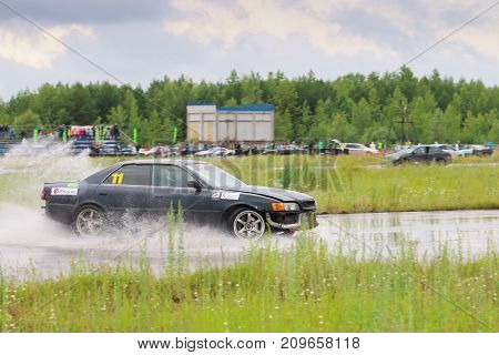 PERM RUSSIA - JUL 22 2017: Drifting black car on track during Open Ural Championship Drift 2017