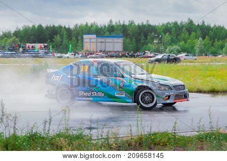 PERM RUSSIA - JUL 22 2017: Drifting car move on wet asphalt track at Open Ural Championship Drift 2017