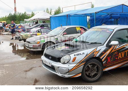 PERM RUSSIA - JUL 22 2017: Sport cars with advertising at Open Ural Championship Drift 2017