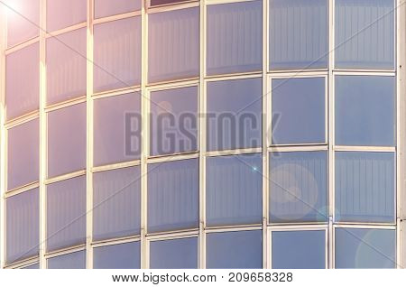 Modern window glass facade skycreaper corporate business with lans flare