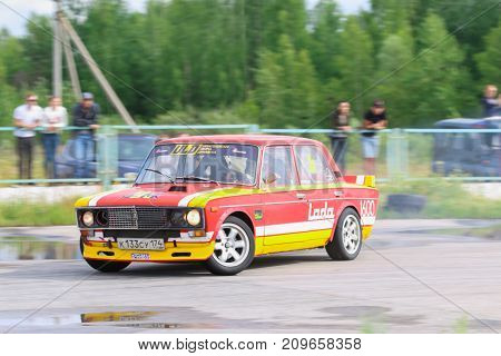 PERM RUSSIA - JUL 22 2017: Drifting red car on race wet track at Open Ural Championship Drift 2017