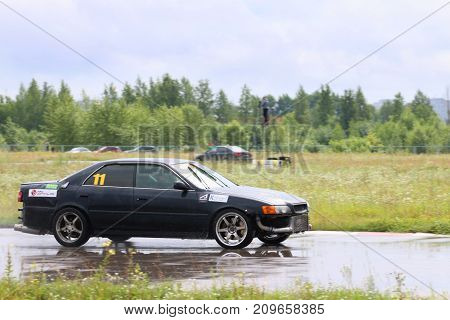 PERM RUSSIA - JUL 22 2017: Drifting black modern car on wet track during Open Ural Championship Drift 2017