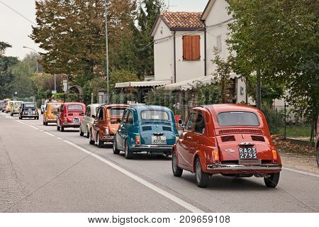 GODO (RUSSI) RAVENNA, ITALY - OCTOBER 1: line of vintage Italian cars Fiat 500 in classic car rally