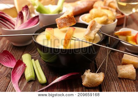 cheese fondue with bread and vegetable