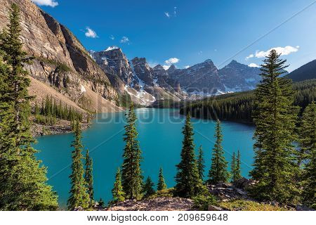 Sunset at Rocky Mountains - Moraine lake in Banff National Park of Canada