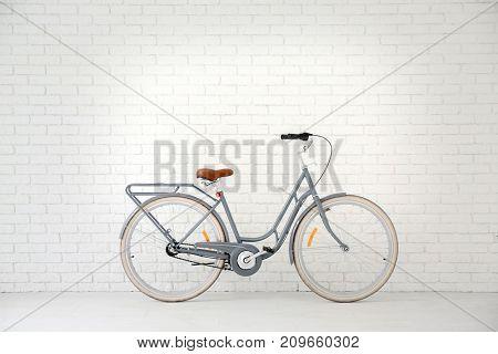 Retro bicycle near white brick wall