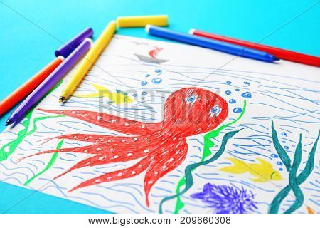 Child's drawing of underwater world on color background, closeup