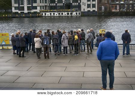 Berlin Germany - October 8 2017: People waiting for a tour with a tourist boat on Spree River in the middle of Berlin October 8 2017.