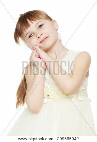 Studio portrait of a beautiful little girl. The concept of fashion, family happiness, harmonious development of the child. Isolated on white background.
