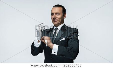 At Your service, well dressed man waiting for orders isolated on white background with copy space at studio