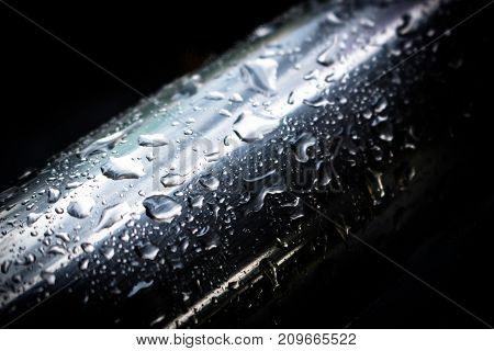 Water droplets on a stainless steel surface