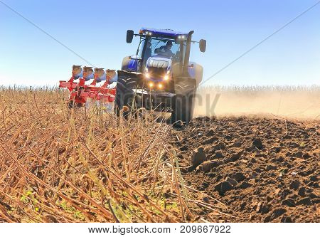 Work Of A Powerful Tractor In Field Cultivation And Cultivation.