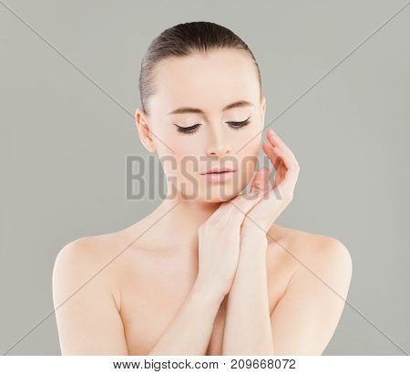 Spa Female Face. Beautiful Woman Spa Model with Healthy Skin Relaxing. Spa Beauty Facial Treatment and Cosmetology Concept