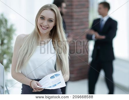 successful young business woman with financial graphs