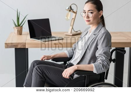 Disabled Asian Businesswoman In Office