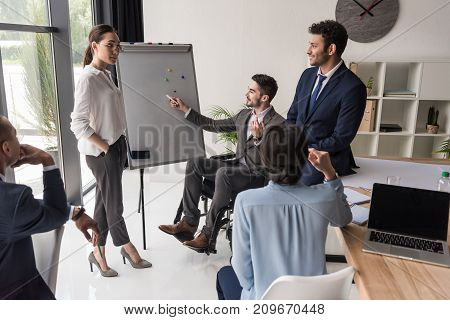 multicultural group of businesspeople discussing business strategy