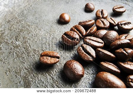 Coffee beans on a gray background close up