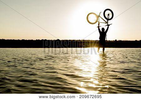 bike driving success & lake and biker