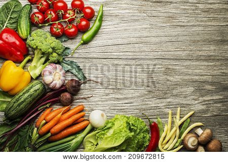 Various fresh vegetables and ingredients on wooden rustic background