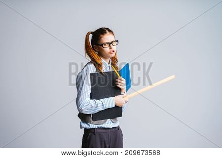 girl student with a frustrated facial expression holding files