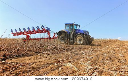 Close-up Work Of A Combine Harvester With A Wheat Field