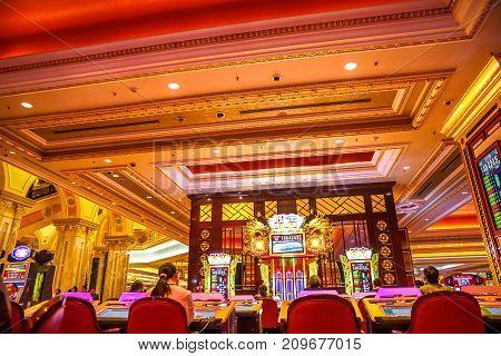 Macau, China - December 9, 2016: game machine inside The Venetian Casino. The Venetian Macau Casino is the famous gambling spot in Macao.