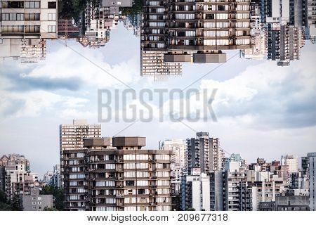 Trees by buildings in city against sky