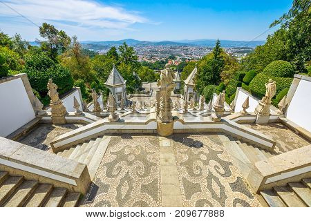 Tenoes in north of Portugal. The monumental baroque staircase of Bom Jesus do Monte Sanctuary, a popular pilgrimage destination with panoramic views overlooking Braga cityscape from top of mountain.