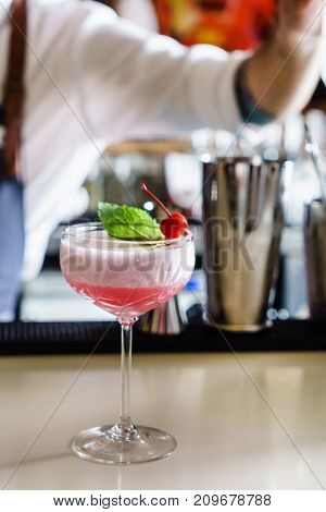 barman making cocktail in the bar