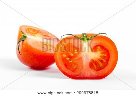 Small Tomato Cut, Close-up, On White Background