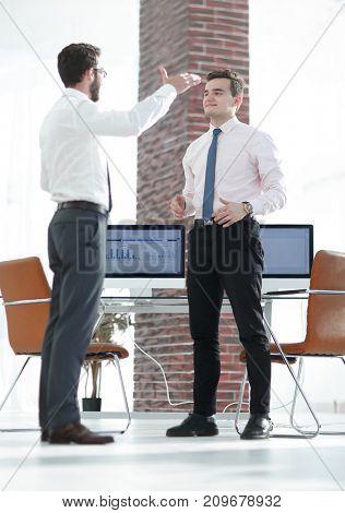 managers discuss marketing scheme