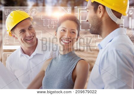 Happy architect discussing over blueprint against high angle view of muddy construction site