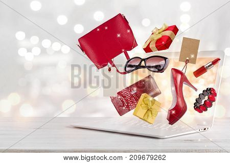 Electronic commerce concept with laptop computer and various gift products