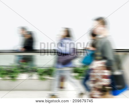 Walking subway passengers in motion blur. Big city life concept
