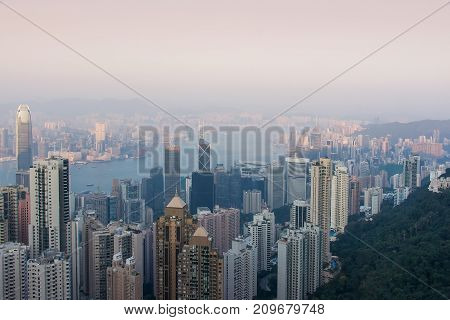 Modern skyscrapers of Hong Kong island from the top of Victoria peak at sunset