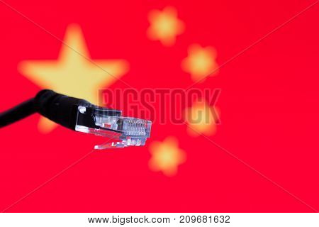 Ethernet cable with chinese flag in the background symbolizing internet in China