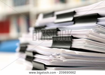 Stack of documents with binder clips, closeup