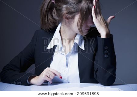 Angers stressed and frustrated business woman breaking pencil as a symbol of the difficulties and problems in business. Woman going crazy with work. Low wages overtime working hours lack of career prospects concept. (Body language gestures psychology)