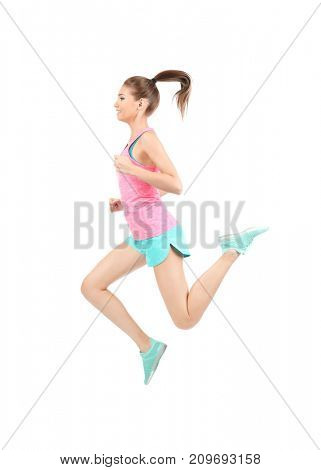 Young sporty woman jumping on white background