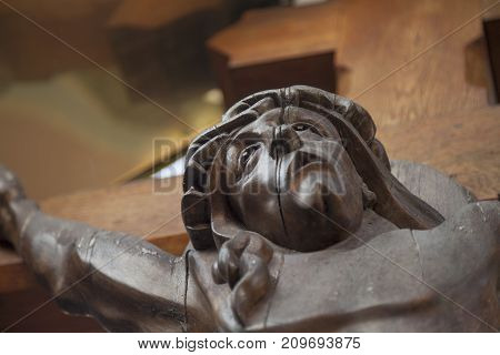 Jesus Christ crucified (Close up of an ancient wooden sculpture)