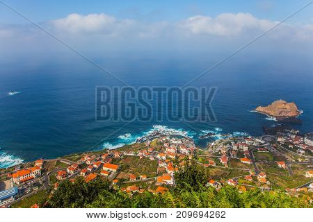 Concept of exotic and ecological tourism. Exotic island in the Atlantic Ocean - Madeira. The picturesque resort settlement on the ocean coast