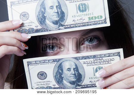 I love money! Beautiful business woman holding cash as symbol of love for Dollars. (Purposefulness motivation wealth success freedom concept)